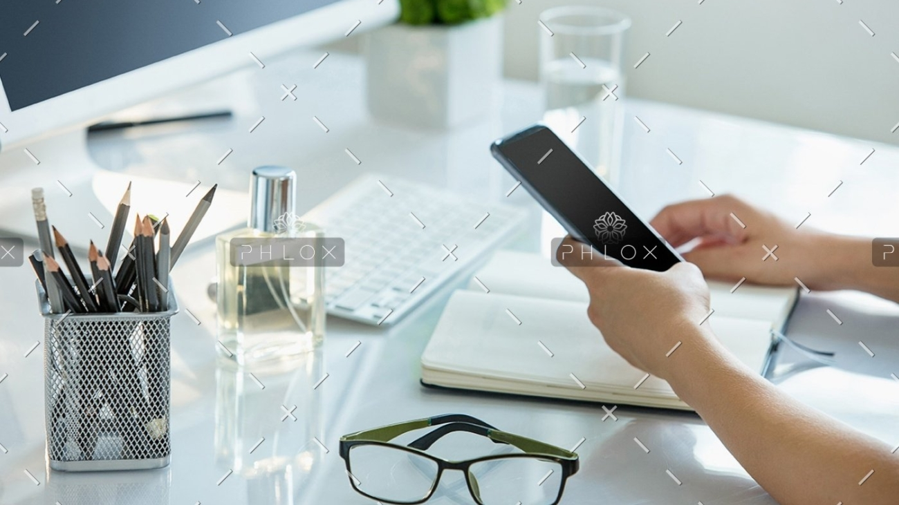 demo-attachment-1148-close-up-of-female-hands-using-smart-phone-while-PWQR3QP